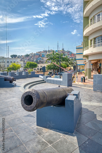 Vászonkép An old cannon in the El Planchado (The Ironed) neighborhood, with Guayaquil city in the background, on a beautiful summer sunny morning