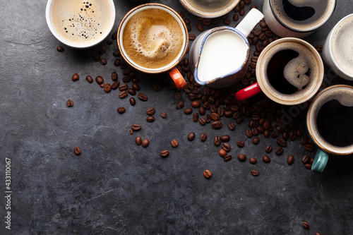 Obraz Many cups of coffee on stone table - fototapety do salonu