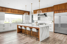 Beautiful Kitchen In New Luxury Home With Large Waterfall Island, Gorgeous Backsplash And Cabinets.