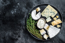 French Cheese Plate. Camembert, Brie, Gorgonzola And Blue Cream Cheese. Black Background. Top View. Copy Space