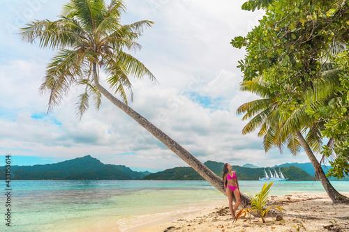 Beach vacation summer paradise destination in Bora Bora island, Tahiti, French Polynesia island cruise excursion. Woman in bikini relaxing on idyllic holiday secluded getaway. - fototapety na wymiar