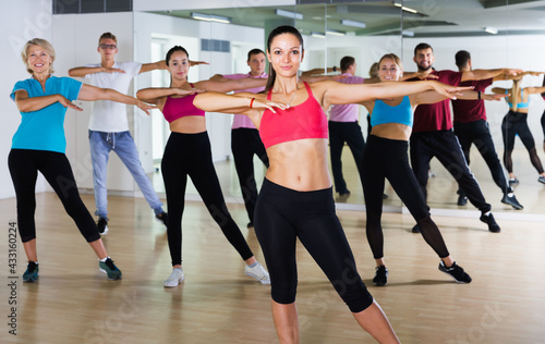 Different ages people learning swing steps at dance class and smiling Wallpaper Mural