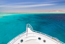 Cruise Yacht Bow In Clear Water Near A Coral Reef. Red Sea, Egypt