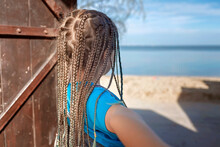 Preteen Happy Girl Opening Wooden Door To Sunny Seaside, Follow Me Shot, Hello Summer Concept, Family Travel, Vacation And Holidays, Freedom After Lockdown