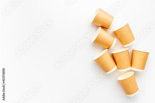 Obraz Paper take away coffee cups flat lay. Top view - fototapety do salonu