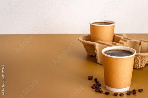 Obraz Black coffee in paper cups with beans. Take away coffee background - fototapety do salonu