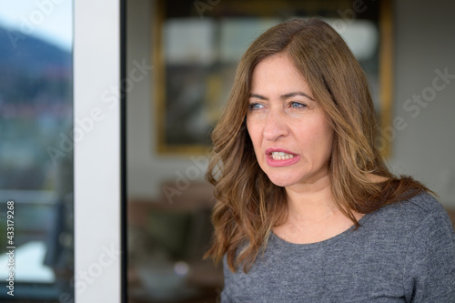 Thoughtful woman grinding her teeth in concentration Fotobehang
