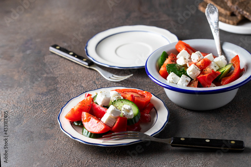 Wallpaper Mural Rustic bowl with Greek salad made with fresh vegetables cucumber, tomato, sweet pepper and  feta cheese on concrete table