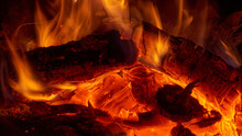 Close Up View Of The Small Fire And Embers In A Campfire Or In A Fireplace.