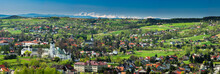 Wide Panoramic View Over Monastery And Cityscape Of Tuchow,Poland With Tatra Mountains Range In Background