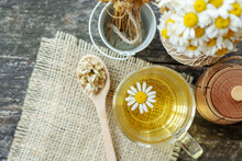 Bouquet Of Daisy Flowers Chamomile, Cup Of Herbal Chamomile Tea With Fresh  Background, Treatment And Prevention Of Immune Concept