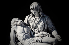 Mother Mary With The Dead Jesus In Her Arms. Dark Background. Special Tone Effect (concept Of Death).