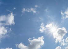 Blue Sky And White Clouds With Sunburst Over Southwest Florida USA