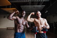 Handsome Shirtless Male Athletes Flexing Muscles While Standing In Health Club