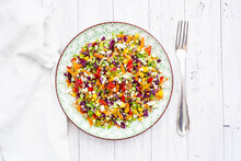 Rainbow Salad Made Out Of Broccoli, Carrot, Corn, Cauliflower, Red Cabbage, Red Bell Pepper