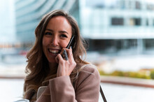 Spain, Madrid, Middle Aged Business Woman Talking By Phone In Urban Scenery, Communication, Businesswoman, Feminity, Commute, Work, City