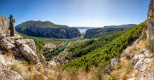 Croatia, Dalmatia, Omis, Statue Of Mila Gojsalic Overlooking Settlement Situated At Forested Bank Of Cetina River In Summer