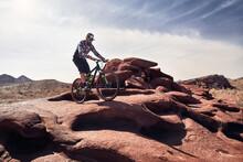 Mountain Biker Rides At The Desert Scenic In Kazakhstan