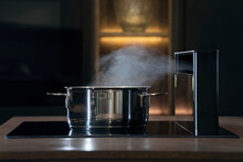 Steaming Pot With Fume Hood In Kitchen;smell;food Preparation;