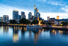 Long Exposure Of The Main With The Financial District Mainhattan Towers Illuminated In The Background, Frankfurt, Germany