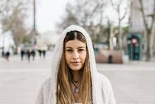 Beautiful Woman In Hooded Jacket On Footpath