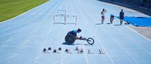 Wheelchair Athlete Preparing On Sunny Blue Sports Track