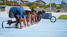Diverse Athletes Ready At Starting Line On Sunny Blue Sports Track