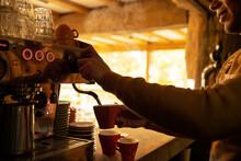 Male Barista Preparing Cappuccino At Espresso Machine In Cafe