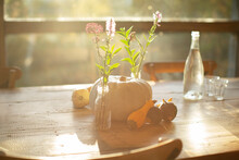 Simple Wildflower Bouquets, Pumpkins And Gourds On Sunny Autumn Table