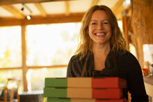 Portrait Happy Female Pizzeria Owner With Pizza Boxes