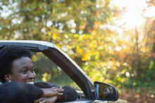 Happy Woman In Convertible In Autumn Park