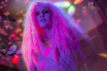 Portrait Confident Woman With Pink Hair In Nightclub