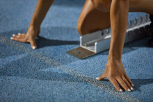 Close Up Female Track And Field Athlete At Starting Block