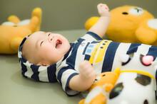 Portrait Of Cute Boy Lying Down Toy