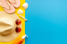 Summer Holiday Background With Beach Hat And Flip Flops. Top View