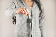 Woman Holding Lock