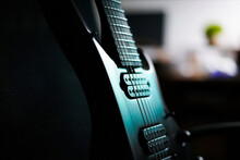 Closeup Shot Of A Black Electric Guitar Fragment With Strings