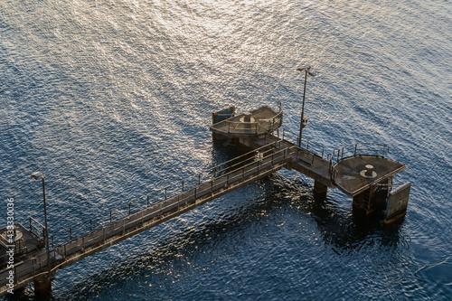 Fototapeta Birds eye view of jetty in ocean