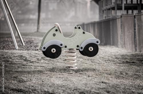 Fototapeta childs spring car in play park