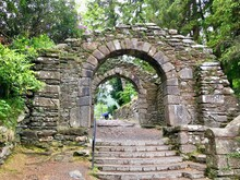 Old Stone Arched Entrance Glendalough In Ireland