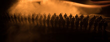 War Concept. Military Silhouettes Fighting Scene On War Fog Sky Background, World War Soldiers Silhouette Below Cloudy Skyline At Night. Battle In Ruined City.