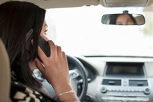 Young Woman On Cell Phone In Car