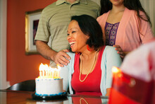 Woman Smiling Over Birthday Cake