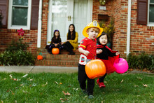 Boy Dressed As Fireman With Trick Or Treat Bucket