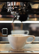 Coffee Flowing From Coffee Machine In Coffee Shop, Close-up