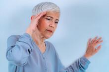 Vertigo. Senior Woman Suffering From Vertigo Dizziness.
