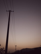 In Summer, On The Outskirts Of The Evening, The Sky Becomes Dim, And Telephone Poles And Wires Stand By The Roadside.