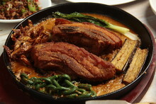 Filipino Food Called Kare Kare Or Meat And Vegetables Cooked In Savory Thick Peanut Sauce