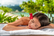 Body Care Massage At Outside Spa On Beach At Luxury Vacation Resort. Asian Beauty Woman Relaxing Sleeping Lying On Table During Aromatherapy Treatment With Coconut Oil.