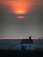 Sunrise On Lake Neusiedlersee With Small Chapel In The Foreground